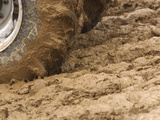 Tire Churning Through Mud
