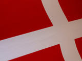 Close-up of the Denmark Flag with a White Cross on Red Fabric