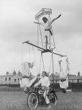 Motorcycle Acrobat Troupe Called &quot;The Promenade Percies&quot; Practise Their Act Involving Balance