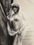 A Young Woman Posing Naked: a Veil Covers Her Hair and Comes Down Her Body