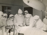 Group of Student Nurses in Theatre Observing a Surgeon Performing an Operation