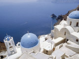 Churches with Blue Domes  on a Cliff Top Overlooking the Sea  at Ia (Oia) on Island of Santorini
