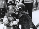 A Girl Delicately Kissing a Dwarf Dressed as a Clown on the Cheek