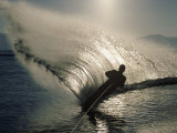 Waterskier Silhouetted with Sun Shining Through Water
