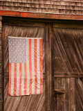 Faded American Flag on Old Barn Entrance  Maine  USA