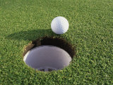 Close-up of a Golf Ball Near a Hole