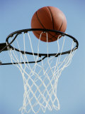 Close-up of a Basketball on The Edge of a Hoop