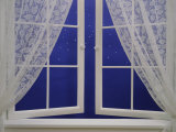 Open Window with Lace Curtains and Simulated Stars Beyond