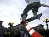 Skateboarder in Midair Knocking Over a Cone