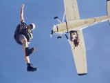 Skydivers Jumping from Plane