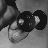 Close-up of a Man Lifting a Dumbbell