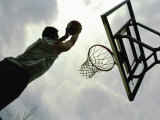 Low Angle View of a Man Shooting a Basket