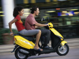Young Couple Riding on a Motor Scooter
