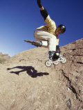 Teen Boy in Off Road Rollerblades Jumping