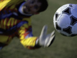 Goalie Attempting to Stop a Soccer Ball