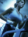 Low Angle View of a Young Woman Running on a Treadmill
