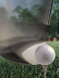 Close-up of a Golf Club Hitting a Golf Ball on a Tee