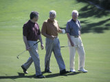 Three Senior Men Walking on a Golf Course