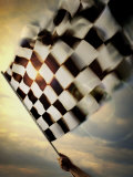 Person&#39;s Hand Waving a Checkered Flag