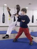 Young Man Teaching a Boy Martial Arts