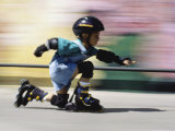 Boy on Rollerblades Crouching