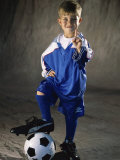 Portrait of a Boy Standing with His Foot on a Soccer Ball
