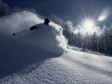 Skier in a Cloud of Snow with Sunburst