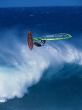 Person Windsurfing in the Sea