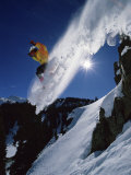 Airborne Snowboarder with Sunburst