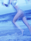 Side Profile of a Woman Running on the Beach