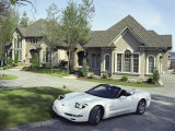 Home with a Sports Car Parked in Front
