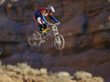 Side Profile of a Person on a Bicycle in Mid Air