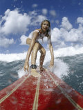 On-surfboard View of a Female Surfer