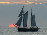 A Sailing Ship Sails During Sunset Towards the Harbor of Bremerhaven