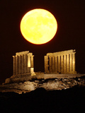 The Full Moon Rises Behind the Ancient Temple of Posseidon