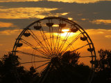 The Ferris Wheel at the Ingham County Fair is Silhouetted against the Setting Sun
