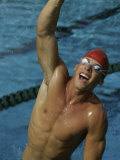 High Angle View of a Male Swimmer Raising His Hands in the Air