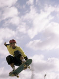 Low Angle View of a Young Man Skateboarding in Mid Air
