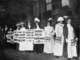 A Line of Women Rally for Women&#39;s Suffrage