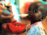 An Unidentified Baby is Fed at a Home for Hiv/Aids and Abandoned Children