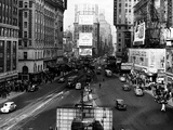 Visitors and Residents of New York City Spend Their Time Window-Shopping Around the Times Square