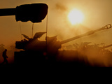 An Israeli Soldier Runs to Reload an Israeli Mobile Artillery Piece