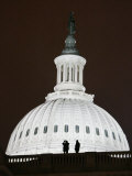 Security Agents Stand Watch on the Roof of the US Capitol