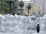 A Child Plays Among the Snowmen Made at the Arbat