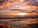 A Young Boy Takes an Early Morning Jog as the Sun Rises Along China Beach