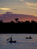 Boaters on Amazon River at Sunset  Amazon River Basin  Peru