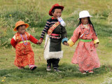 Young Tibetan Children Walk Hand in Hand Near Qinghai Lake