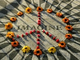 A Makeshift Peace Sign of Flowers Lies on Top John Lennon&#39;s Strawberry Fields Memorial