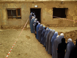 Afghan Women Wearing Burqa Line up to Vote at a Polling Station