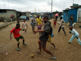 Children Play Soccer in an Impoverished Street in Lagos  Nigeria